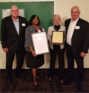 Eldon Strong, Blossom Mabon holding framed resolution, Magot Sabato holding framed award, Senator Rick Niemeyer