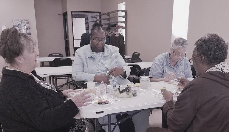 Seniors enjoying a lunch courtesy of LCCS